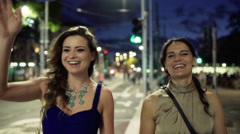 Friends meeting in the street at night, steadycam shot Stock Footage