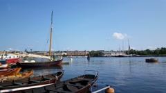 Pier with classic boats at Skeppsholmen Stockholm Sweden Stock Footage