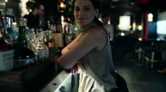 Woman standing in the pub and smiling to the camera, steadycam shot Stock Footage