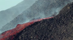 Mount Etna with small lava flow from vent Stock Footage