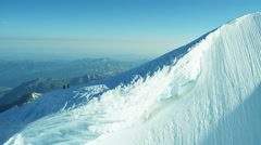 Aerial Swiss Monch summit Alps climbers snow ice snow - stock footage