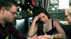 Couple having a quarrel in the pub, steadycam shot Stock Footage