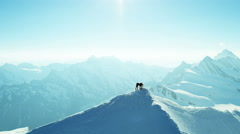 Aerial Swiss mountain Alps mountaineering snow climbers travel - stock footage