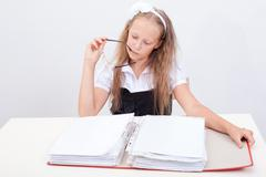 Schoolgirl with folder - stock photo