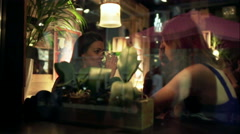 Friends sitting in the pub and having a good time, steadycam shot Stock Footage
