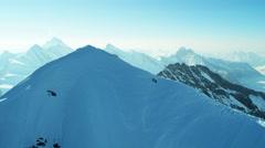 Aerial Switzerland Jungfrau summit mountain climbers Alps - stock footage