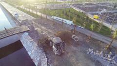 Wheel excavator tractor working at construction site. Aerial Camera Stock Footage