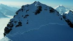 Aerial Switzerland Jungfrau summit mountaineering Alps snow - stock footage