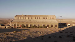 Abandoned buildings and houses in Kolmanskop, a ghost town in the Namib desert Stock Footage