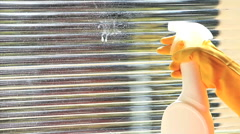 Woman Hand Spray Cleaner Liquid Wipe Window With Squeegee Tool. Window cleaner Stock Footage