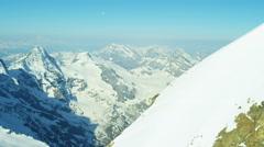 Aerial Swiss Jungfrau mountain summit climbers Alps snow ice - stock footage