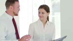 The manager explains the subordinate what to do Stock Footage