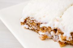 Slice of Delicious White Cream Cake on White Plate - stock photo
