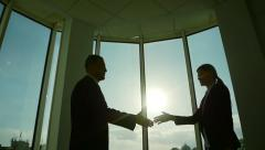 Two business partner shake hands when meeting Stock Footage