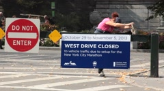 Central Park Entrance from Upper Fifth with Joggers and Walkers - stock footage