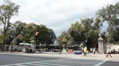 Central Park from Fifth Avenue with pedestrians, dog walkers and traffic Stock Footage