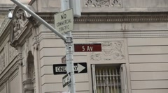 Pan from 5th Avenue Sign to Beautiful Facade of Frick Collection Stock Footage