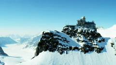 Aerial Switzerland Jungfraujoch Sphinx Observatory mountain Alps Stock Footage