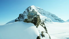 Aerial Switzerland Jungfraujoch Sphinx Observatory mountain Alps snow Stock Footage