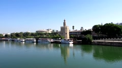 Panoramic view of the Golden Tower, in the Guadalquivir river from the bridge Stock Footage