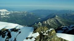 Aerial Swiss Jungfraujoch Sphinx Observatory Grindelwald mountain Alps Stock Footage