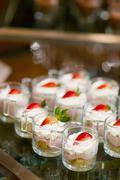 many servings of sweet tasty dessert on buffet - stock photo
