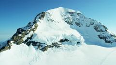 Aerial Swiss Monch summit Alps snow ice snow skiing sport Stock Footage