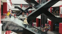 Stock Video Footage of escalators and shoppers in the mall Fifth Avenue