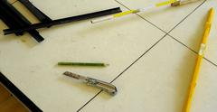 level, utility knife, strips, eec. tools work for a floating floor on steel f - stock photo