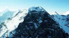 Aerial Switzerland Grindelwald Eiger mountain summit Alps travel Stock Footage