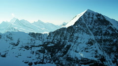 Stock Video Footage of Aerial Switzerland Monch mountain Alps snow ice glacier