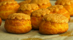 Hot and gliden choux buns from oven - rotating quickly Stock Footage