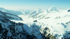 Aerial Switzerland Monch mountain Alps snow ice glacier - stock footage