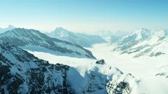 Aerial Swiss Monch summit Alps snow ice sport climbing Stock Footage