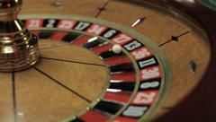 Casino: Roulette in motion, ball stops at black thirteen Stock Footage