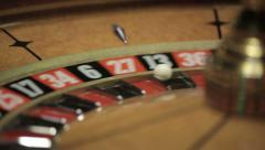 Casino: Roulette in motion, ball stops at black thirteen - stock footage