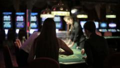 People placing bets for roulette in casino Stock Footage