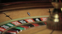 Casino: Roulette in motion, ball stops at black fifteen Stock Footage