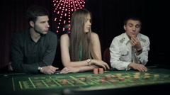 People placing bets for roulette in casino. Steadicam shot Stock Footage
