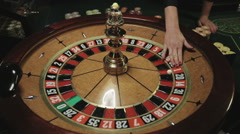 Casino: Roulette in motion, ball stops at black twenty five Stock Footage