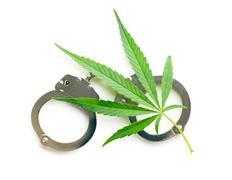 Cannabis leaf and handcuffs Kuvituskuvat