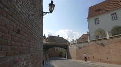 Liars Bridge connecting two brick walls in Sibiu - stock footage