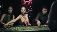 People placing bets for roulette in casino. Slider camera movement - stock footage