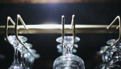 Wine glasses hanging from a rack. Slider movement camera Stock Footage
