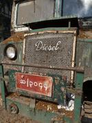 Front view and grill of a dilapidated and weathered vintage bus in Yangon, My - stock photo