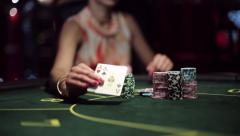 Casino, poker: African american woman player shows two aces and takes win - stock footage
