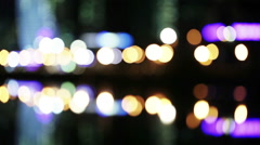 Bokeh night traffic reflection water Stock Footage