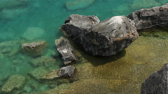 Overhead view from cliff of rocks and water of Georgian bay. Stock Footage