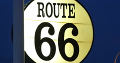 4K lit up antique vintage highway Route 66 sign at night Stock Footage