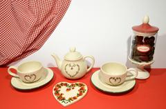 China tea set, sweets and heart icon - stock photo